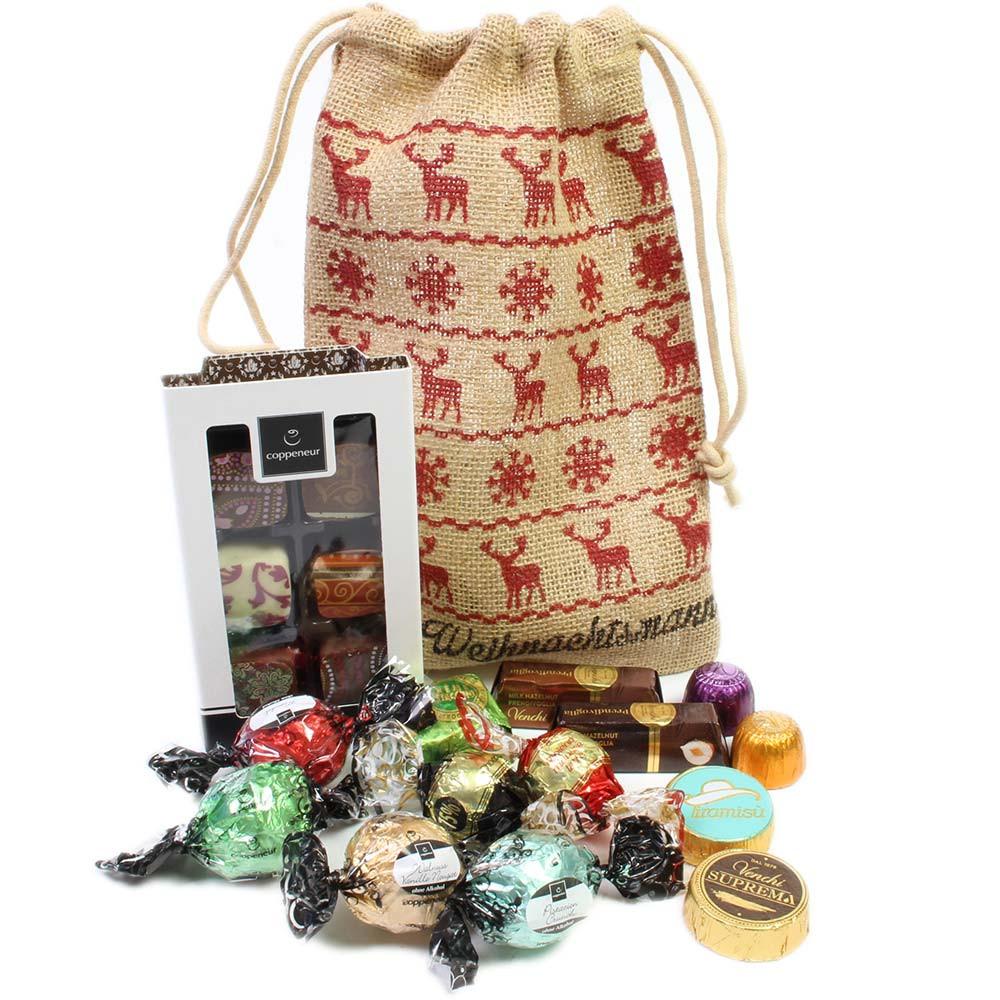 Kerstman zak gevuld met herten voor Kerstmis